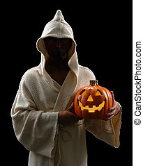 Hooded Man With Jack-o-Lantern - Hooded man holding...
