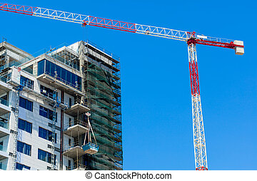 Hoisting crane and house - Hoisting crane is building house....