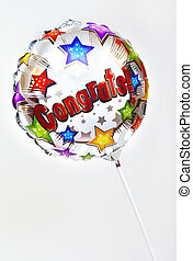Congrats Balloon - A 'Congratulations' balloon over a plain...