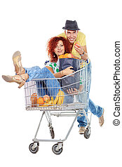 crazy customer - Cheerful couple with a shopping trolley....