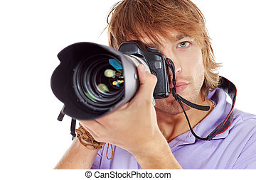 paparazzo - Handsome young man taking pictures on the camera...