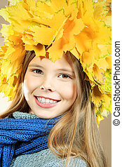 leafage - Portrait of a smiling girl in autumn clothes and a...