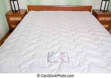 Bed mattress. Bedroom interior - White bed matress close up,...