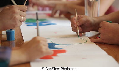 Art courses - People drawing with watercolors during art...