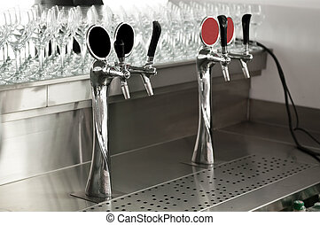 chrome beer taps at the bar in the pub