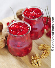 viburnum jam - Jars with homemade viburnum jam on a wooden...