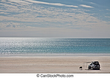 Four Wheel Drive on Beach - Lanscape view of a lonely...