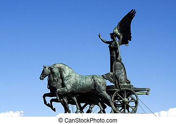 Statue of the goddess Victoria riding on quadriga on the top...