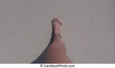 woman feet walking on beach 30 - woman legs walking on...