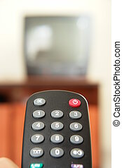 TV zapping - Television screen with tv remote control in...