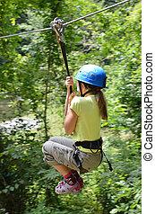 Preteen girl zipping down - Preteen girl is zipping down at...