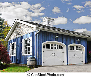 Two car garage - Double car garage with white doors and blue...