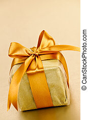 Golden wrapped gift box - Gift box in gold wrapping paper...