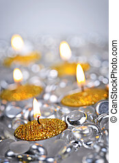 Gold Christmas candles - Burning golden decorative Christmas...