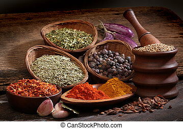 Different spices over a wood background. Various colors and...