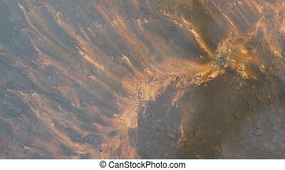 Sandy bottom of the river. - The patterns on the sandy...
