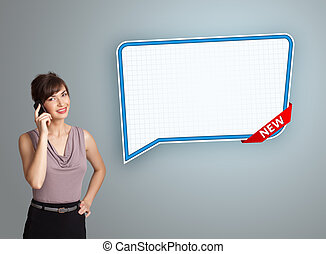 Beautiful young woman standing next to a modern speech bubble copy space and making phone call