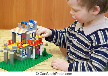 Small creator build a house - Small boy play with building...