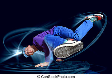 Modern style dancer posing against dark background with...