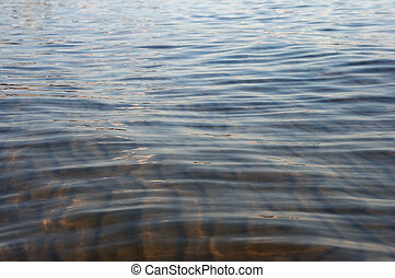 Sea bottom and waves - Sandy sea bottom in through water and...