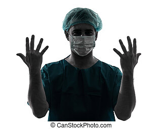 doctor surgeon man portrait with face mask showing hands