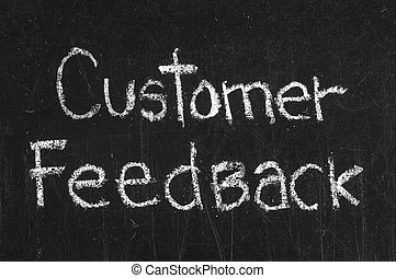 Chalk drawing -CUSTOMER FEEDBACK word written on chalkboard