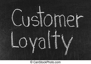CUSTOMER LOYALTY written on blackboard background high...