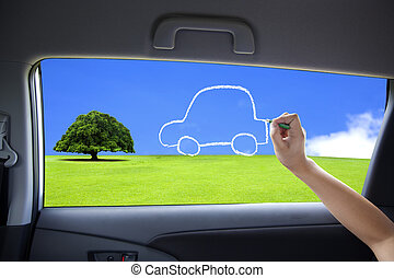hand drawing eco green car concept on the car windows