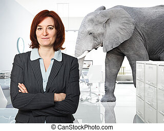 trouble in office - portrait of woman in office and elephant...