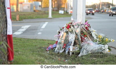Flowers Mark Police Officers Death - A roadside memorial...
