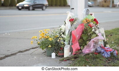 Roadside Memorial Marker - Flowers at a busy intersection...
