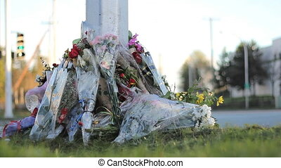 Police Officer Roadside Memorial - A roadside memorial marks...