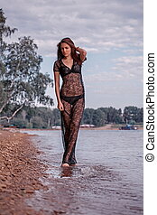 Fashionable woman by lake