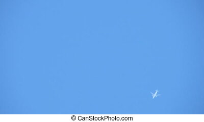 Plane - Bottom view of flying plane over blue sky