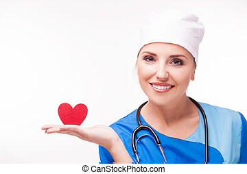 cardiologist isolated - cardiologist with a red heart in her...