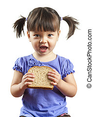 Young child eating sandwich - Young child about to eat...