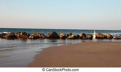Girl jogging along a Beach  2