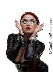 Woman in latex costume looking up