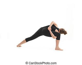 young blonde woman in yoga pose - back view of adavnced...