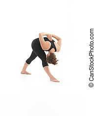 demonstration of contorting yoga posture - young blonde...
