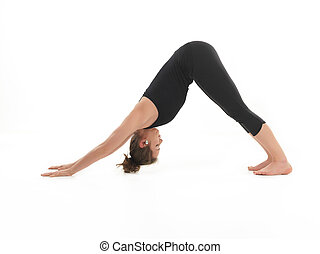 stretching yoga posture - young woman sitting in stretching...