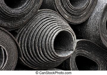 rolls of black foam - background with rolls of black foam...