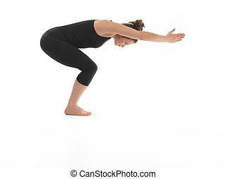 beginner yoga pose demonstration - side view of young woman...