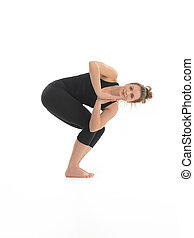 advanced yoga practice - young woman demonstrating difficult...