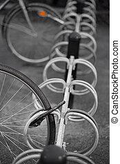 Bike wheel - Locked wheel of bicycle in bicycle rack