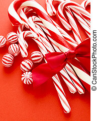 Candy cane - White and red peppermint candy canes on red...