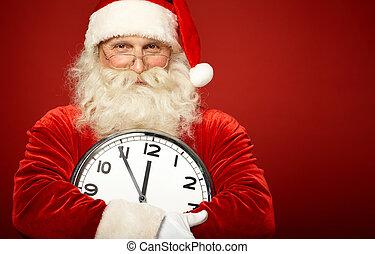 Santa with clock - Photo of happy Santa holding clock...