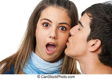 Surprised by kiss on cheek - Cute girl with surprised look...