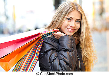 Cheerful woman shopping