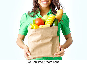 Provision - Image of paper packet full of different fruits...